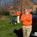 Bruce Leaman watches while son Tyler applies fertilizer
